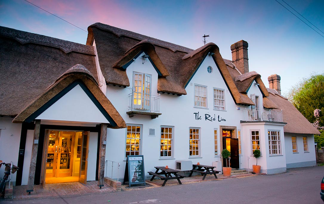 white thatched pub at night
