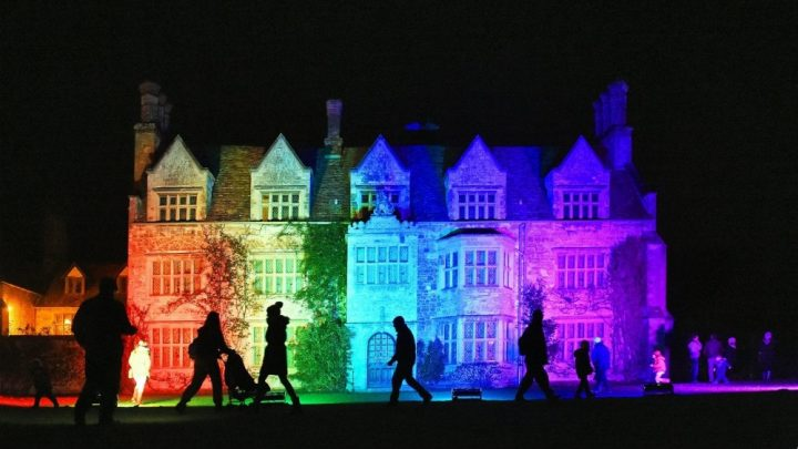 stately home light up in colourful lights