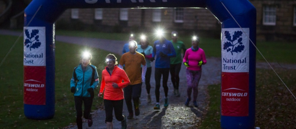 runners at night wearing head torches