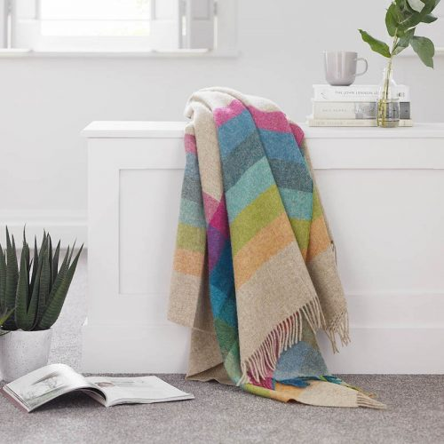multi-coloured throw draped over side