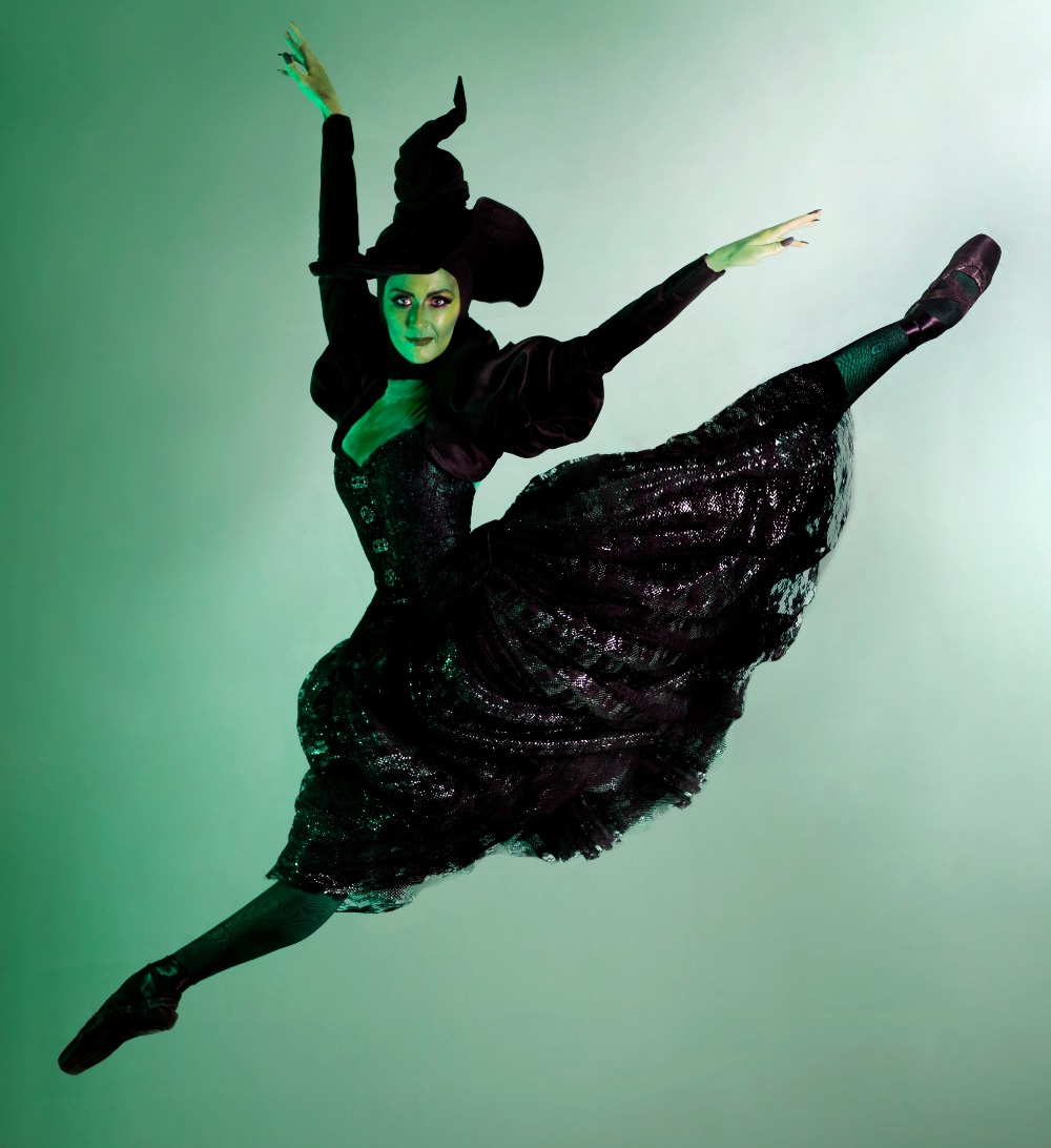 ballet dancer dressed as witch doing a grand jete