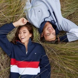 two people lying down in casual clothes